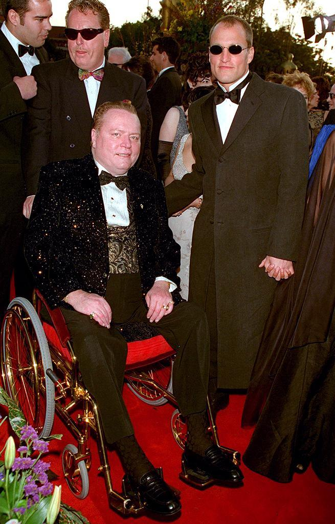 <p>Nominated for Best Actor for his role in 'The People vs. Larry Flynt,' Harrelson posed with the real-life Flynt on the red carpet. (Photo: Frank Trapper/Getty Images) </p>