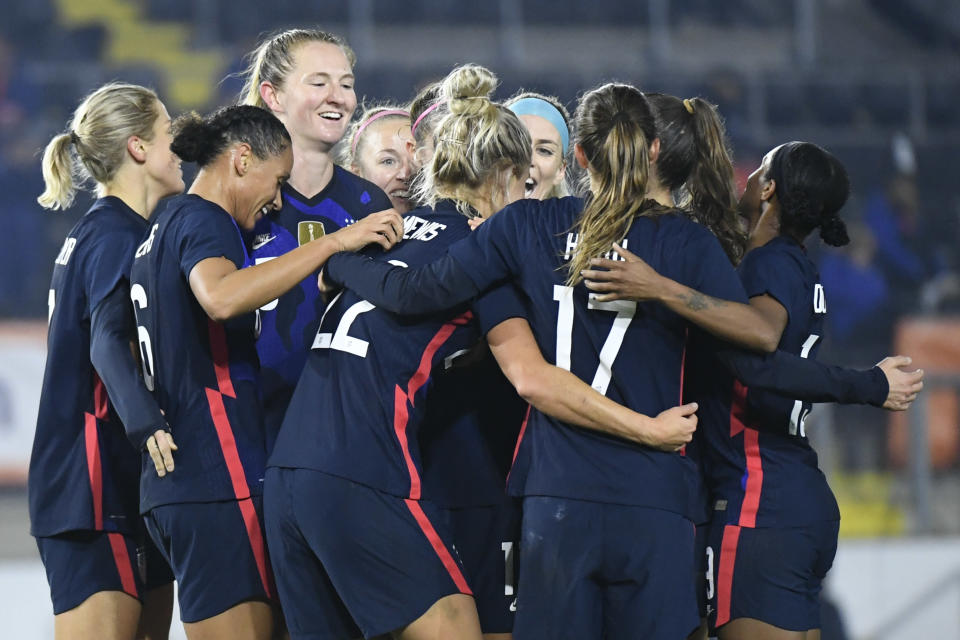 United States players celebrate with Kristie Mewis, number 22, who scored her side's second goal during the international friendly women's soccer match between The Netherlands and the US at the Rat Verlegh stadium in Breda, southern Netherlands, Friday Nov. 27, 2020. (Piroschka van de Wouw/Pool via AP)