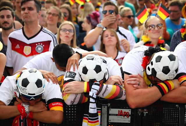 <p>Germany fans react as they watch the match at a public viewing area at Brandenburg Gate. REUTERS/Hannibal Hanschke </p>