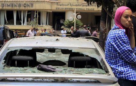 A car damaged as a result of a car bomb attack on the convoy of Egyptian public prosecutor Hisham Barakat near his house at Heliopolis district, is seen in Cairo, Egypt, June 29, 2015. REUTERS/Mohamed Abd El Ghany