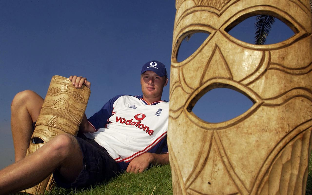 PORT ELIZABETH, SOUTH AFRICA - FEBRUARY 27:   Andrew Flintoff of England poses with African masks after a press conference at the Holiday Inn in Port Elizabeth, South Africa on February 27, 2003. (Photo by Tom Shaw/Getty Images)