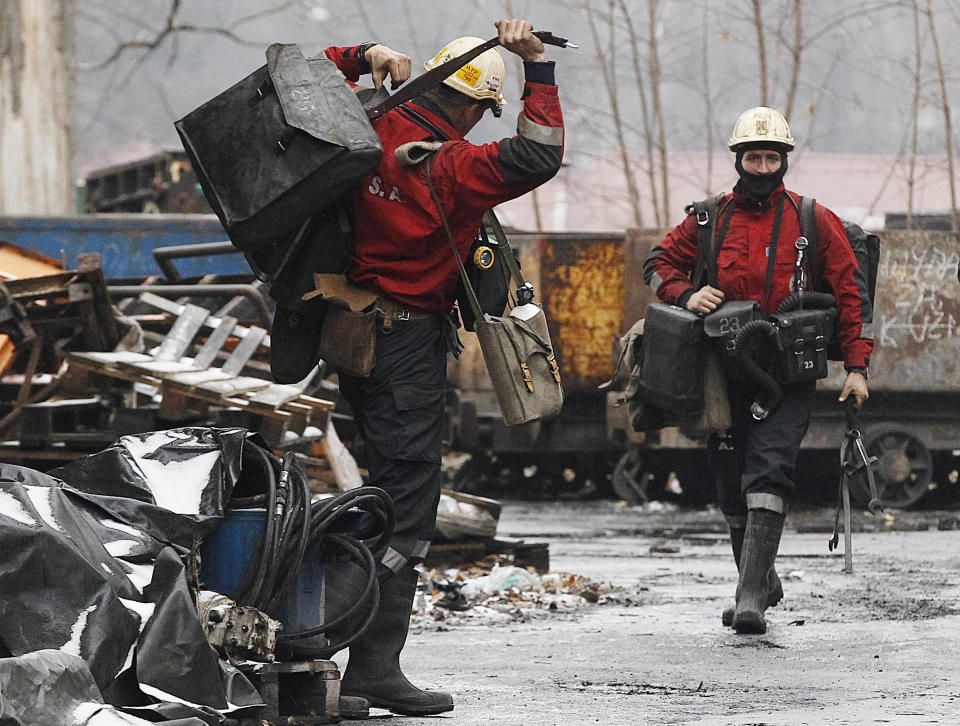FILE - In this Nov. 21, 2018, file photo, a mining rescue team arrives for a regular shift at the Wujek coal mine in Katowice, in southern Poland. The coronavirus has ripped through Poland's coal mines, where men descend deep underground in tightly packed elevators and work shoulder-to-shoulder. The virus hot spots, centered in the southern Silesia region, have paralyzed an already-troubled industry, forcing many to stay home from work and triggering a three-week closure of many state-run mines. (AP Photo/Czarek Sokolowski, File)