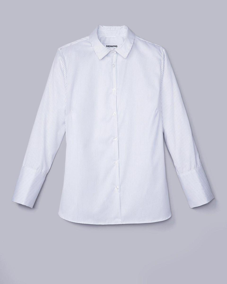 """<p><strong>Henning</strong></p><p>henningnyc.com</p><p><strong>$249.00</strong></p><p><a href=""""https://henningnyc.com/collections/shop/products/dovetail-shirt-1#newsletter"""" rel=""""nofollow noopener"""" target=""""_blank"""" data-ylk=""""slk:Shop Now"""" class=""""link rapid-noclick-resp"""">Shop Now</a></p><p>Henning founder Lauren Chan tested heaps of button-downs before designing her own, with extended sizes in mind. Features that help this top earn a place in your closet? Wrinkle resistant-fabric, slightly oversized sleeves, and covert buttons to prevent any awkward gaping.</p>"""