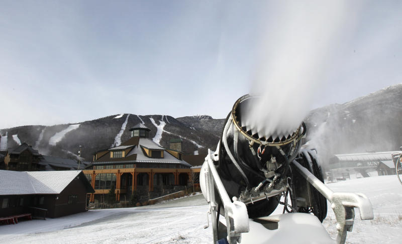 This Nov. 15, 2012 photo shows a snow gun making fresh snow at the Stowe resort  in Stowe, Vt. The ground might be bare, but ski areas across the Northeast are making big investments in high-efficiency snowmaking so they can open more terrain earlier and longer. (AP Photo/Toby Talbot)
