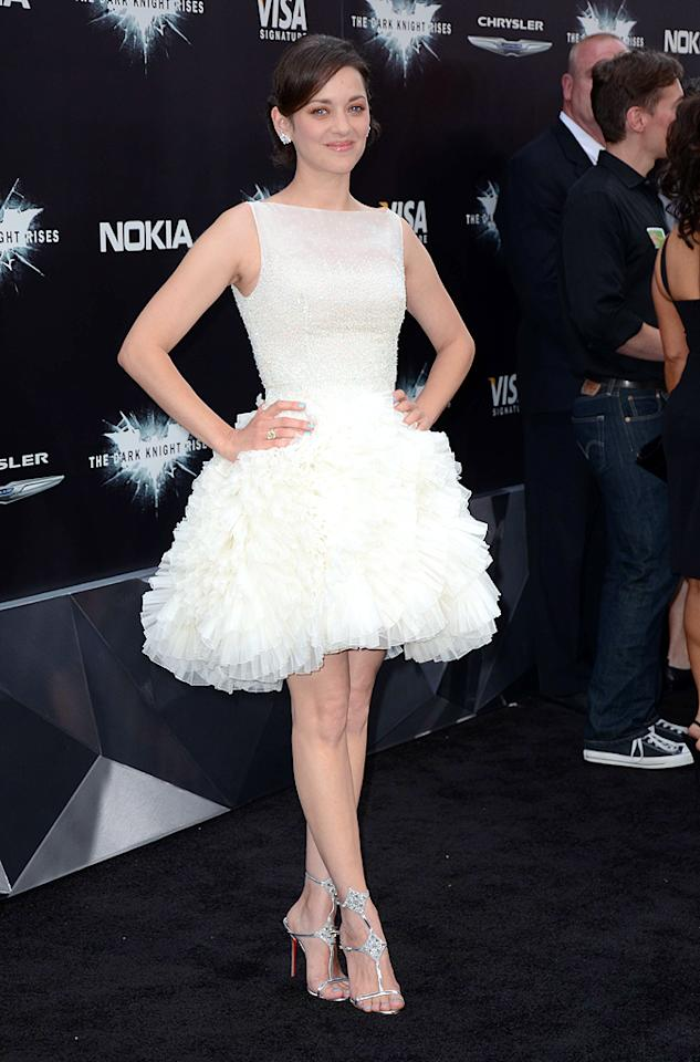 """Two days earlier, Cotillard caused a commotion in yet another Dior gem. For the soon-to-be blockbuster's NYC debut, she donned this ballerina-like cocktail frock and silver Christian Louboutin sandals. Flawless. (7/16/2012)<br><br><a target=""""_blank"""" href=""""http://twitter.com/YahooOmg"""">Follow omg! on Twitter!</a><br><br><a target=""""_blank"""" href=""""http://bit.ly/lifeontheMlist"""">Follow 2 Hot 2 Handle creator, Matt Whitfield, on Twitter!</a>"""