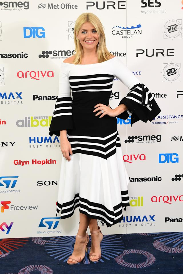 <p>The blonde beauty chose a demure monochrome dress for the TRIC awards earlier this year. <em>[Photo: PA]</em> </p>