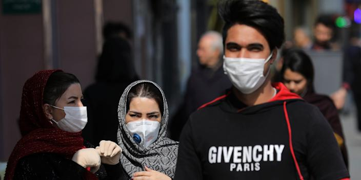 Pedestrians wear masks to help guard against the Coronavirus, in downtown Tehran, Iran, Sunday, Feb. 23, 2020. On Sunday Iran's health ministry raised the death toll from the new virus to 8 people in the country, amid concerns that clusters there, as well as in Italy and South Korea, could signal a serious new stage in its global spread. (AP Photo/Ebrahim Noroozi)