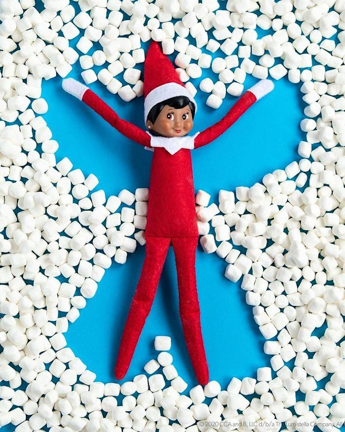 """<p>If you've got to stay at home this winter, why not bring the fun of the outdoors...inside? These marshmallows make it easy for your Scout Elf to construct his very own """"snow angel.""""</p><p><strong>Get the tutorial at <a href=""""https://elfontheshelf.com/elf-ideas/scout-elf-snow-angel/"""" rel=""""nofollow noopener"""" target=""""_blank"""" data-ylk=""""slk:Elf on the Shelf"""" class=""""link rapid-noclick-resp"""">Elf on the Shelf</a>.</strong> </p>"""