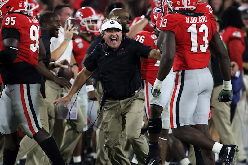 Georgia Bulldogs head coach Kirby Smart celebrates a fourth-quarter interception during his team's win over the Notre Dame Fighting Irish on Saturday. (Getty)