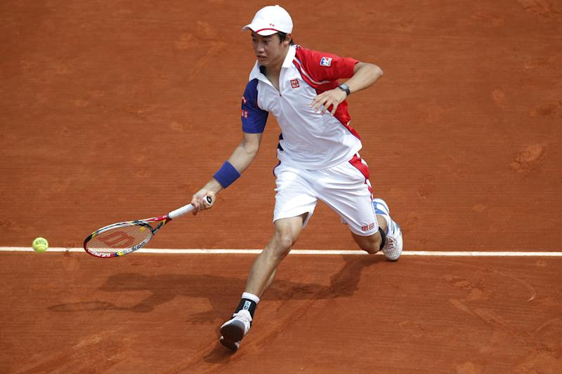 Japan's Kei Nishikori returns against Benoit Paire of France in their third round match at the French Open tennis tournament, at Roland Garros stadium in Paris, Saturday, June 1, 2013. (AP Photo/Christophe Ena)
