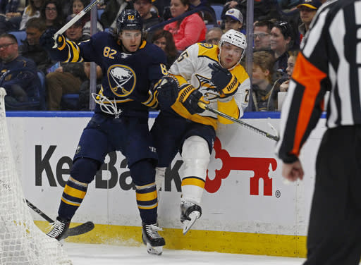 Buffalo Sabres defenseman Nathan Beaulieu (82) checks Nashville Predators defenseman Alexei Emelin (25) during the second period of an NHL hockey game Monday, March 19, 2018, in Buffalo, N.Y. (AP Photo/Jeffrey T. Barnes)