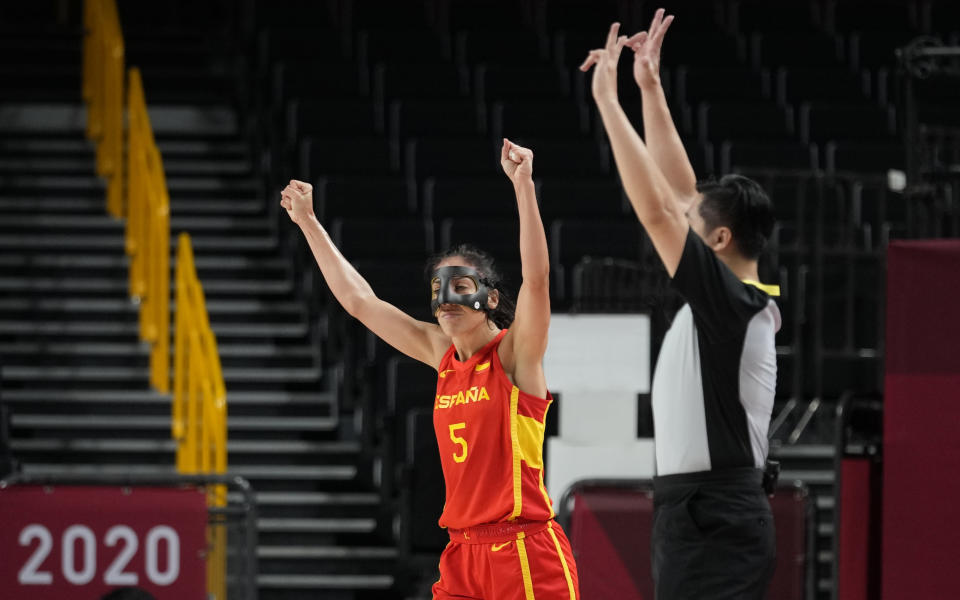 Spain's Cristina Ouvina (5) celebrates during women's basketball preliminary round game against Canada at the 2020 Summer Olympics, Sunday, Aug. 1, 2021, in Saitama, Japan. (AP Photo/Eric Gay)