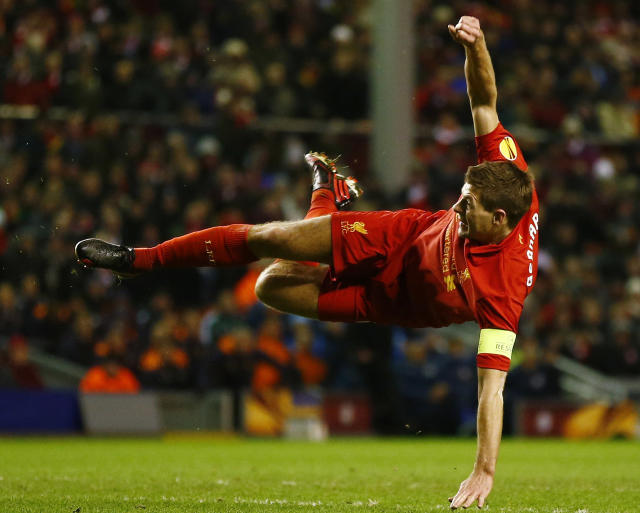 Liverpool's Steven Gerrard shoots at goal during their Europa League soccer match against Zenit St. Petersburg at Anfield in Liverpool, northern England, February 21, 2013. REUTERS/Darren Staples (BRITAIN - Tags: SPORT SOCCER) - RTR3E3HA