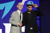 James Bouknight, right, poses for a photo with NBA Commissioner Adam Silver after being selected 11th overall by the Charlotte Hornets during the NBA basketball draft, Thursday, July 29, 2021, in New York. (AP Photo/Corey Sipkin)