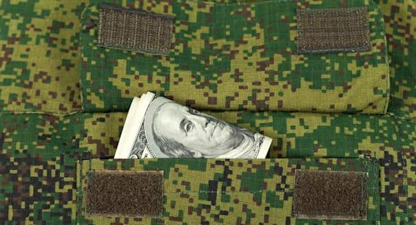CXHGWJ Banknotes in the military uniform pocket  military; uniform; banknote; currency; cash; army; army; background; banknote;