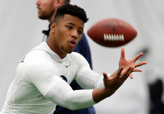 File-This March 20, 2018, file photo shows running back Saquon Barkley catching a football during Penn State NFL football Pro Day in State College, Pa. Barkley is the best player in this year's draft. Yet he might not go in the first handful of picks Thursday night. Huh? Blame the desperation to find quarterbacks in great part for the possibility that the Penn State All-America running back could fall well below where his talent, character and versatility warrant. (AP Photo/Gene J. Puskar, File)