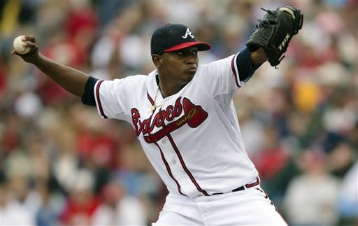 Atlanta Braves pitcher Julio Teheran delivers a pitch in the first inning of an exhibition spring training baseball game against the St. Louis Cardinals on Tuesday, March 12, 2013, in Kissimmee, Fla. (AP Photo/Evan Vucci)