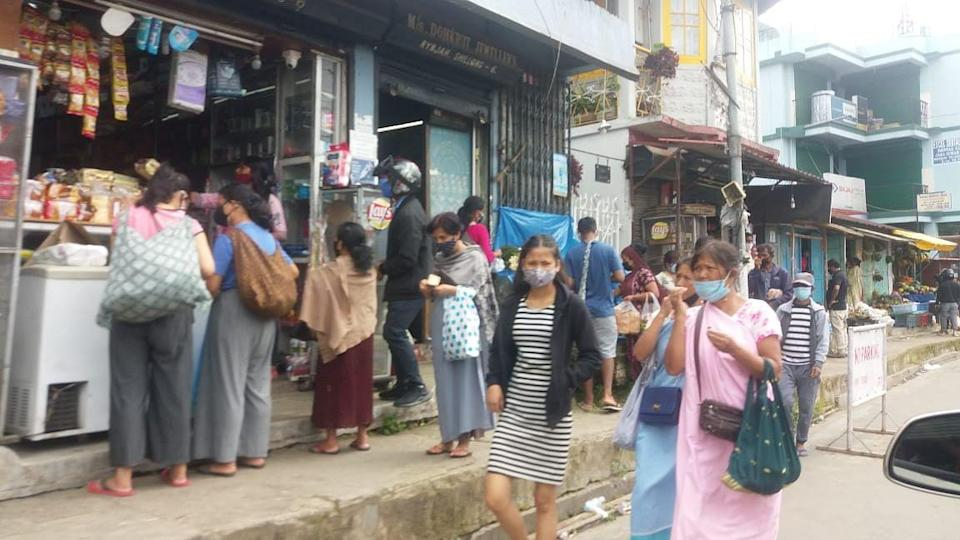 Locals throng a market in Shillong.