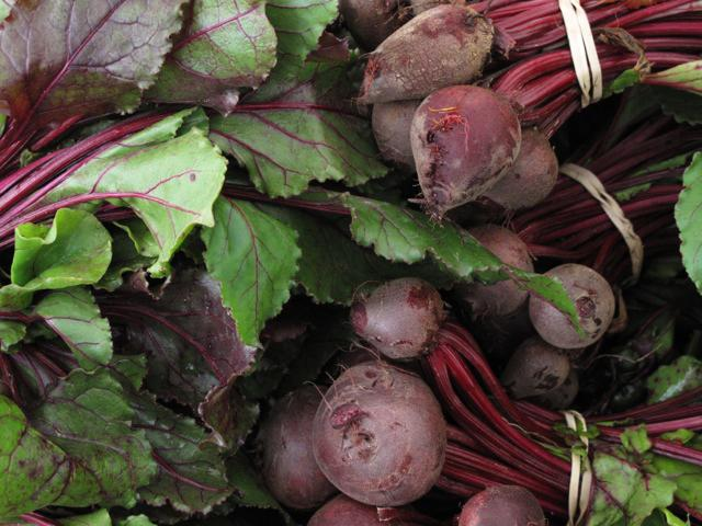 In this May 6, 2010 photo, beets for sale are seen at the Farmer's Market, in Dupont Circle, Washington. Many vegetables get woodier, less succulent and lose some of their sweetness as they grow more mature. Some, however,  like new potatoes, radishes, baby carrots, zucchini, miniature cucumbers, spring peas, turnips and beets offer up their best flavors while young. (AP Photo/Dean Fosdick)