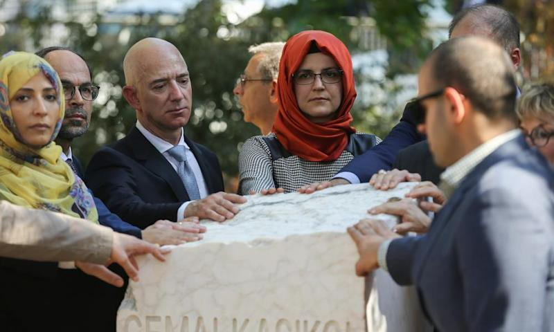 Bezos (third left) and Cengiz (far left) at the unveiling of Khashoggi's monument on 2 October last year, the first anniversary of the journalist's murder.