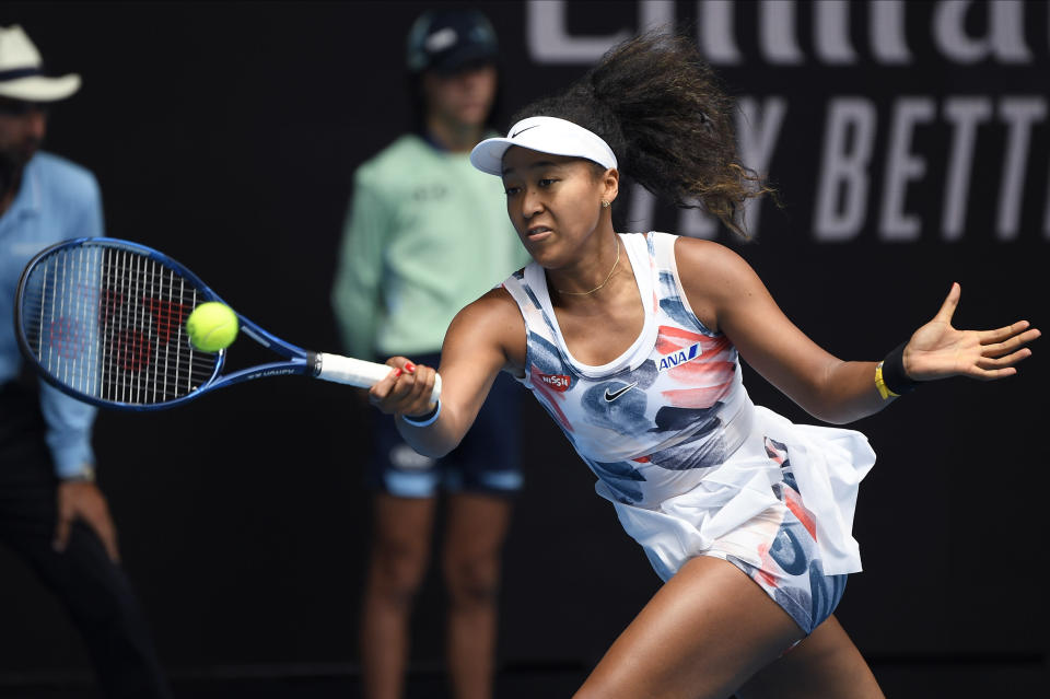 Japan's Naomi Osaka makes a forehand return to China's Zheng Saisai during their second round singles match at the Australian Open tennis championship in Melbourne, Australia, Wednesday, Jan. 22, 2020. (AP Photo/Andy Brownbill)