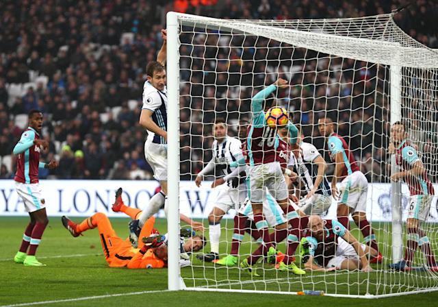 <p>West Brom defender Gareth McAuley deflects home a 94th minute equaliser in their 2-2 draw at West Ham </p>