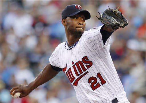 Minnesota Twins starting pitcher Samuel Deduno (21) throws against the Kansas City Royals during the first inning of a baseball game, Thursday, June 27, 2013, in Minneapolis. (AP Photo/Genevieve Ross)