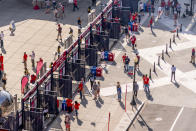 A steady trickle of fans arrive at the centerfield gate as the Washington Nationals play the Atlanta Braves in their opening day baseball game at Nationals Park, Tuesday, April 6, 2021, in Washington. (AP Photo/Andrew Harnik)
