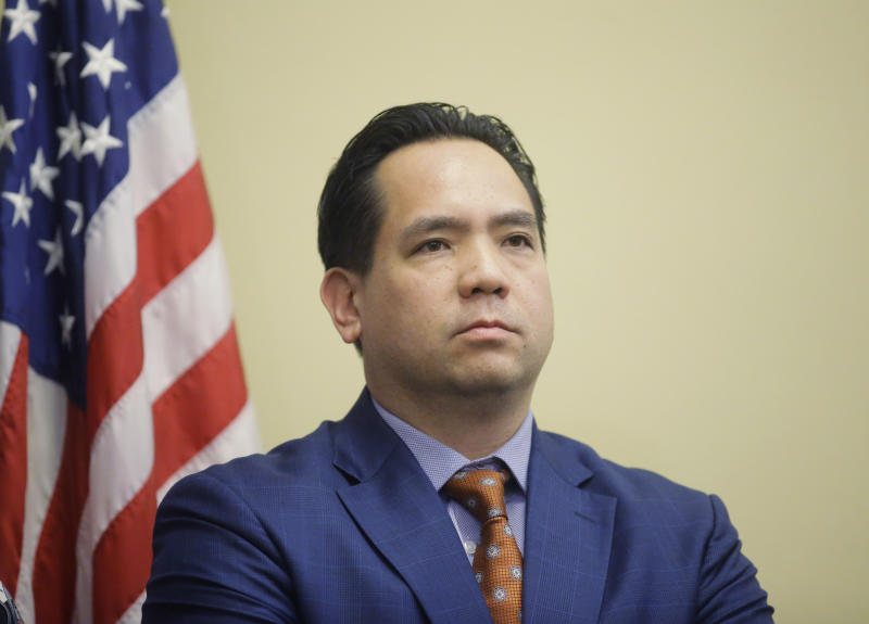 "FILE - In this Feb. 23, 2017, file photo, Utah Attorney General Sean Reyes looks on during a news conference at the Utah State Capitol in Salt Lake City. In a Wednesday, Oct. 9, 2019 statement, Reyes said Maricopa County, Ariz., Assessor Paul Petersen ""is alleged to have run an illegal adoption scheme where he recruited, transported, and offered payment to pregnant Marshallese women to give their babies up for adoption in the United States."" (AP Photo/Rick Bowmer, File)"