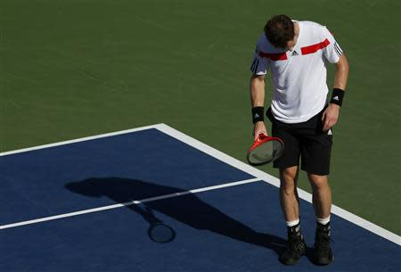 Andy Murray of Britain reacts after a missed point against Stanislas Wawrinka of Switzerland at the U.S. Open tennis championships in New York September 5, 2013. REUTERS/Adam Hunger