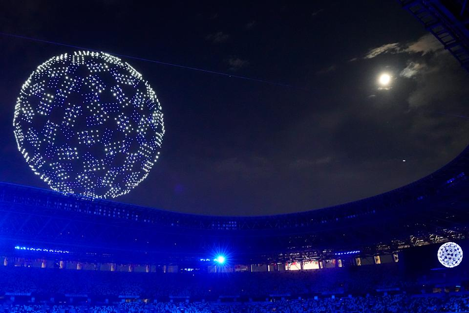 TOKYO, JAPAN - JULY 23: A drone display is seen over the top of the stadium during the Opening Ceremony of the Tokyo 2020 Olympic Games at Olympic Stadium on July 23, 2021 in Tokyo, Japan. (Photo by Wei Zheng/CHINASPORTS/VCG via Getty Images)