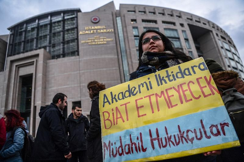 """""""Academia will not bow to the government,"""" reads a placard held by a protester (AFP Photo/OZAN KOSE)"""