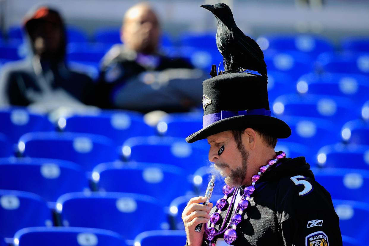 A ravens fan is shown smoking an electronic cigarette before a game between the Baltimore Ravens and Atlanta Falcons at M&T Bank Stadium on October 19, 2014 in Baltimore, Maryland. (Photo: Rob Carr/Getty Images)