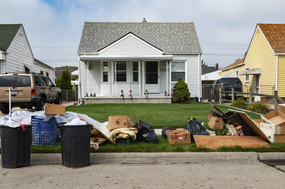 Detroit, Michigan, August 20, 2014: An evicted house at a suburban street with left belongings on the lawns near the 8 mile road, in the city of Detroit.