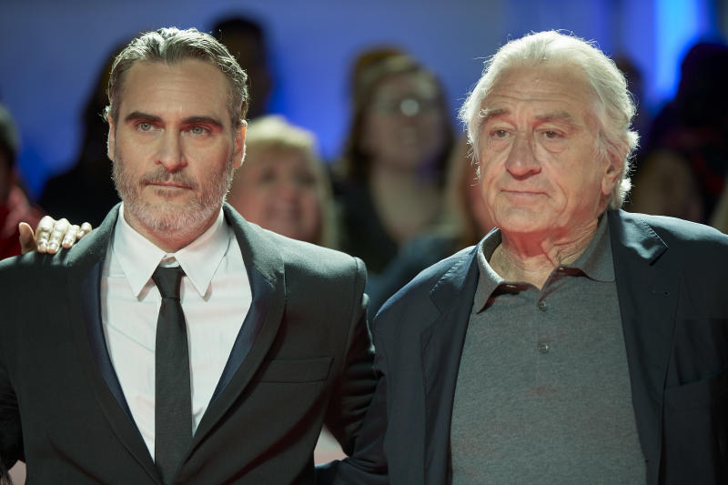 "Actors Joaquin Phoenix (L) and Robert De Niro (R) attend the ""Joker"" premiere during the 2019 Toronto International Film Festival at Roy Thomson Hall on September 09, 2019 in Toronto, Canada. (Photo by Geoff Robins / AFP) (Photo credit should read GEOFF ROBINS/AFP/Getty Images)"