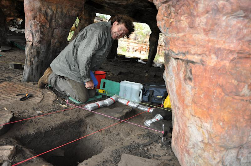 In this May 2012 photo provided by Bryce Barker, University of Southern Queensland archaeologist Bryce Barker investigates Aboriginal rock art in a cave in the Australian Outback. Prof. Barker said Monday, June 18, 2012 that tests show the Aboriginal rock art in the cave was made 28,000 years ago, making it the oldest in Australia and among the oldest in the world. (AP Photo/Bryce Barker) EDITORIAL USE ONLY