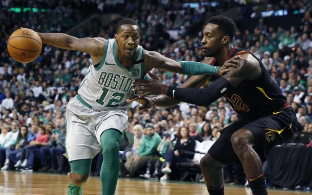 Boston Celtics' Terry Rozier (12) drives past Cleveland Cavaliers' Jeff Green (32) during the first quarter of an NBA basketball game in Boston, Sunday, Feb. 11, 2018. (AP Photo/Michael Dwyer)