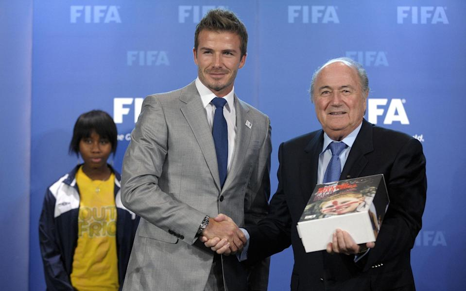 FIFA president Sepp Blatter (R) poses after receiving the bid books for 2018 and 2022 FIFA World Cups from former England football captain David Beckham  - Getty Images