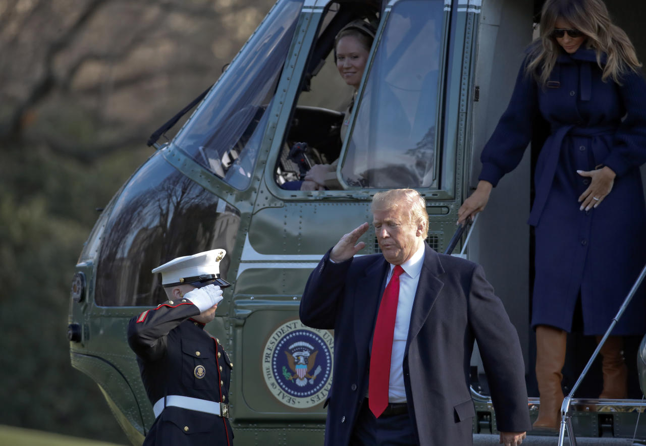 President Donald Trump salutes as he steps off Marine One, accompanied by first lady Melania Trump, on the South Lawn of the White House, Monday, March 19, 2018, in Washington. Trump is returning from a trip to New Hampshire. (AP Photo/Alex Brandon)