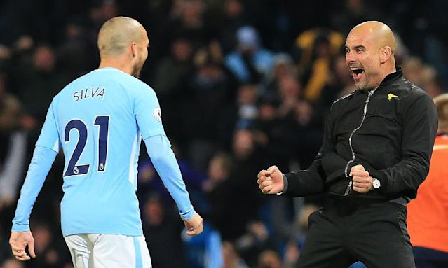 Pep Guardiola, right, celebrates with one of his key players, David Silva, after beating Southampton in the Premier League.