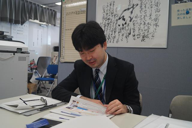 <p>Ryusuke Wakahoi, the deputy director of the Strategic Intelligence Analysis Office, reads through information on North Korea at the Ministry of Defense headquarters in Shinjuku, Tokyo. (Photo: Michael Walsh/Yahoo News) </p>
