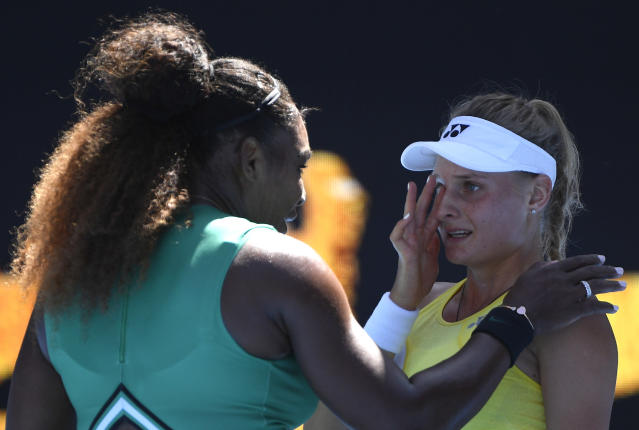 United States' Serena Williams consoles Ukraine's Dayana Yastremska after winning their third round match at the Australian Open tennis championships in Melbourne, Australia, Saturday, Jan. 19, 2019. (AP Photo/Andy Brownbill)