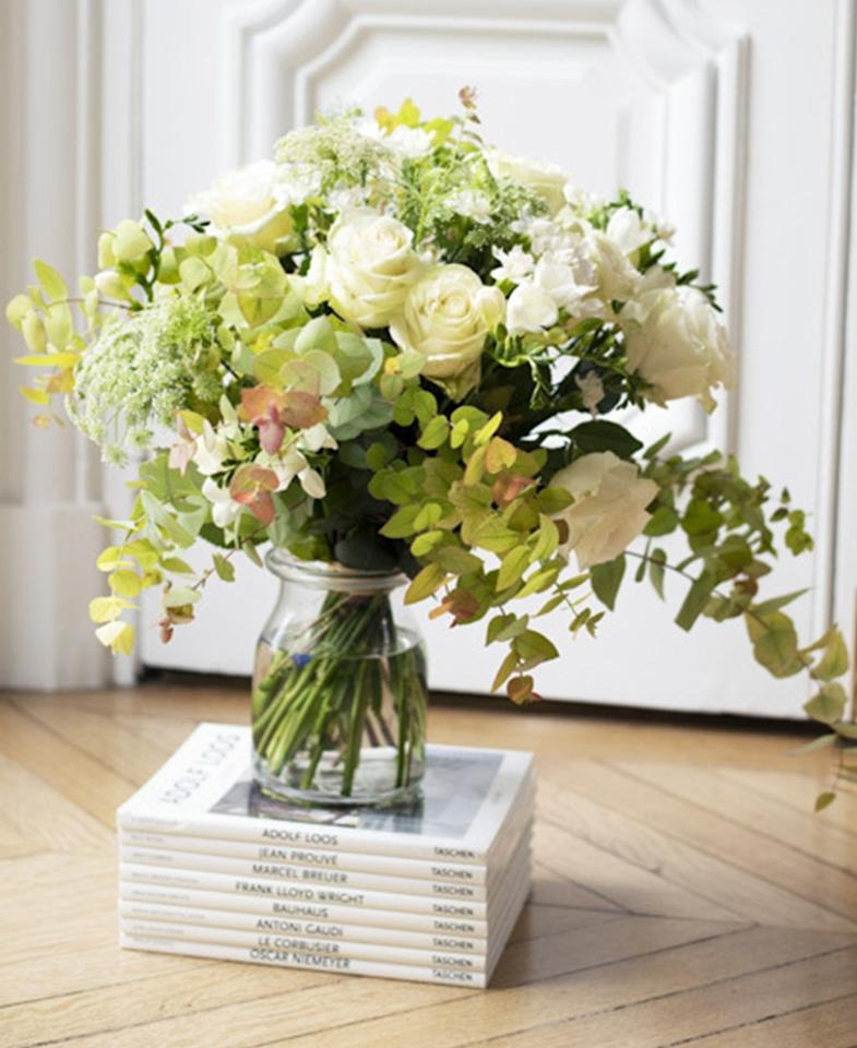 """Ode à la Rose makes bouquets """"the French way,"""" so naturally arrangements come in a beautiful pink box with a French bulldog on them. The flower-delivery service offers same-day shipping in New York City and Chicago and throughout the Northeast. $110, Ode à la Rose. <a href=""""https://www.odealarose.com/product/white-fall-36857"""">Get it now!</a>"""