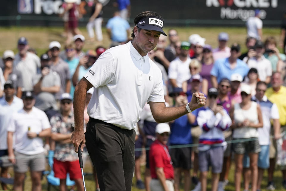 Bubba Watson pumps his fist as he makes a birdie putt on the 18th green during the final round of the Rocket Mortgage Classic golf tournament, Sunday, July 4, 2021, at the Detroit Golf Club in Detroit. (AP Photo/Carlos Osorio)
