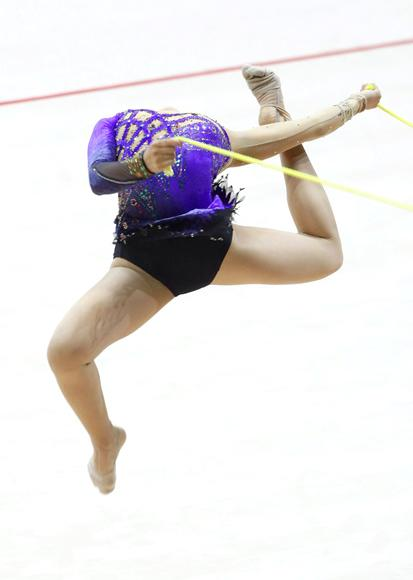 Japan's Nanase Shoji jumps as she performs her routine with the rope during the rhythmic gymnastics qualifying round at the 2009 World Games in Kaohsiung July 17, 2009. The World Games will be held from July 16-26 in the southern Taiwan city of Kaohsiung. REUTERS/Nicky Loh