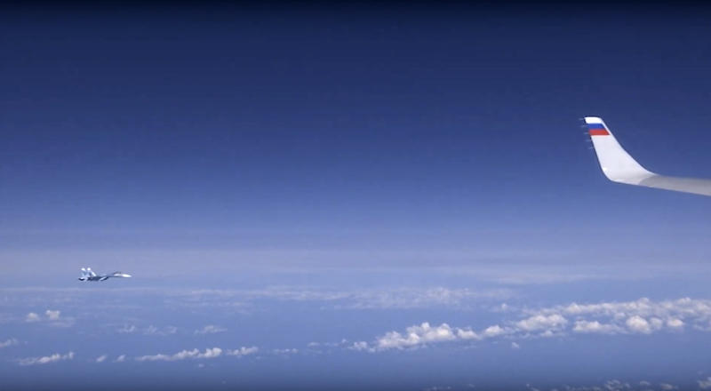 In this video grab taken from a footage on Aug. 13, 2019, and distributed by Russian Defense Ministry Press Service, a view of Russian air force's Su-27 fighter jet, seen from the window of a passenger plane carrying Russian Defense Minister Sergei Shoigu over the Baltic Sea.  A video aired on Russian state television shows a fighter jet warding off a NATO military aircraft that approached a passenger plane carrying Russia's defense minister. (Russian Defense Ministry Press Service via AP)