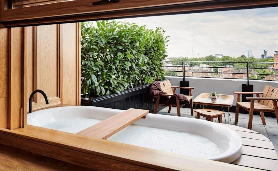 """<p>Want a suite that comes with its own outdoor hot tub? You'll want to check into King's Cross' <a href=""""https://go.redirectingat.com?id=127X1599956&url=https%3A%2F%2Fwww.booking.com%2Fhotel%2Fgb%2Fthe-standard-london.en-gb.html%3Faid%3D2070929%26label%3Dhotel-suites-london&sref=https%3A%2F%2Fwww.redonline.co.uk%2Ftravel%2Fg37383631%2Fhotel-suites%2F"""" rel=""""nofollow noopener"""" target=""""_blank"""" data-ylk=""""slk:The Standard"""" class=""""link rapid-noclick-resp"""">The Standard</a>. The UK outpost of the American hotel brand, this is one of the coolest hotels around (it's hosted the likes of Bella Hadid) and its Junior Suite Terrace offers all the goods: the sweeping view of the iconic London St Pancras, the California modern interior and the incredible terrace featuring its own tub you can enjoy, whatever the weather.</p><p>The extended mini bar, cosy robes and 8th floor location aren't the only things you'll be raving out either. We like the little touches at Red HQ and loved the thoughtful umbrella and rain coat in the suite for when we want to be out exploring but the weather doesn't play ball.</p><p><strong>From £339 per night</strong></p><p><a class=""""link rapid-noclick-resp"""" href=""""https://go.redirectingat.com?id=127X1599956&url=https%3A%2F%2Fwww.booking.com%2Fhotel%2Fgb%2Fthe-standard-london.en-gb.html%3Faid%3D2070929%26label%3Dhotel-suites-london&sref=https%3A%2F%2Fwww.redonline.co.uk%2Ftravel%2Fg37383631%2Fhotel-suites%2F"""" rel=""""nofollow noopener"""" target=""""_blank"""" data-ylk=""""slk:CHECK AVAILABILITY"""">CHECK AVAILABILITY</a></p>"""
