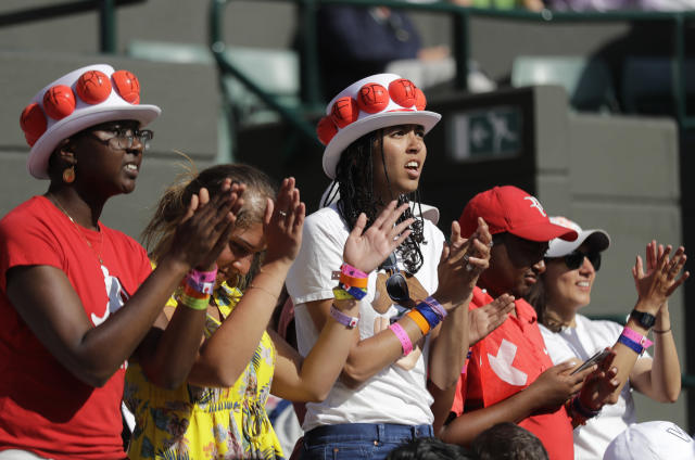 Fans of Switzerland's Roger Federer cheer during the fifth set of his men's quarterfinals match against Kevin Anderson of South Africa at the Wimbledon Tennis Championships, in London, Wednesday July 11, 2018. (AP Photo/Ben Curtis)