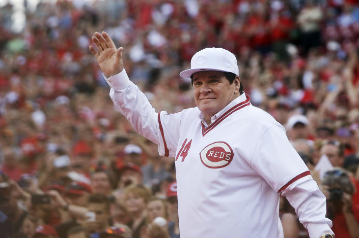 FILE - In this June 24, 2016, file photo, former Cincinnati Red Pete Rose waves to the crowd as he is introduced on the field during a ceremony to honor the 1976 World Series champions team, before the Reds' baseball game against the San Diego Padres in Cincinnati. Rose says cheating on the field is bad for the game, and the one thing he never did with his bets is change the outcome of a game. (AP Photo/John Minchillo, File)