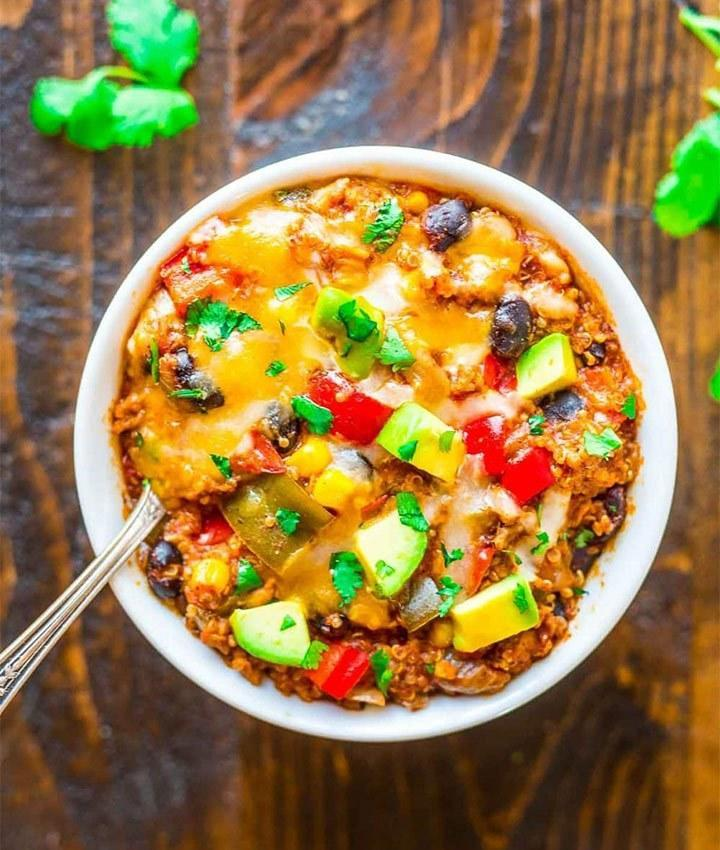 """A crock pot or other slow cooker is a great way to whip up healthy dishes while cutting down on prep time. This Mexican casserole combines classic ingredients like black beans, ground beef, bell pepper, cheese corn, and spices with protein-packed quinoa and <a rel=""""nofollow noopener"""" href=""""https://www.eatthis.com/greek-yogurt/?utm_source=yahoo-news&utm_medium=feed&utm_campaign=yahoo-feed"""" target=""""_blank"""" data-ylk=""""slk:Greek yogurt"""" class=""""link rapid-noclick-resp"""">Greek yogurt</a> for a filling and wholesome meal. <strong>Get the recipe from <a rel=""""nofollow noopener"""" href=""""https://www.wellplated.com/crock-pot-mexican-casserole/"""" target=""""_blank"""" data-ylk=""""slk:Well Plated by Erin"""" class=""""link rapid-noclick-resp"""">Well Plated by Erin</a>.</strong>"""